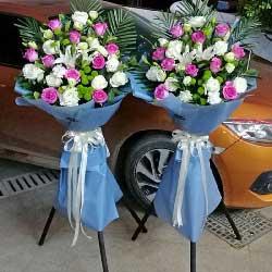 11朵苏醒玫瑰,三脚架开业花篮,财气富足